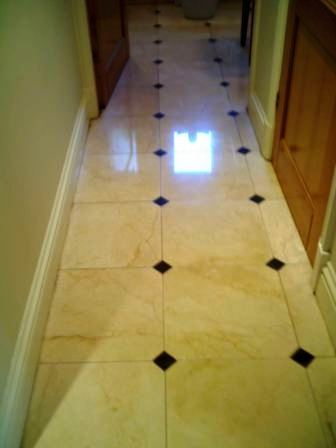 Crema Marfil polished Marble floor after renovation by Tile Doctor