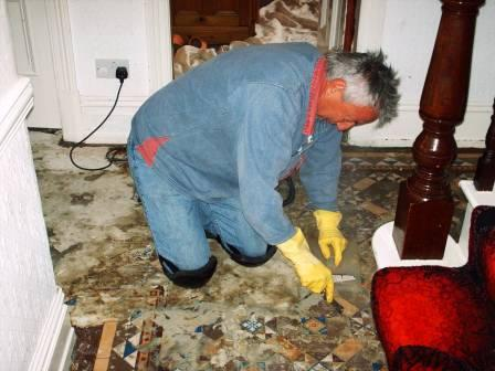 Tile Doctor hard at Work Cleaing Tiled Floors